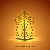 Illuminated arabic lamp or lantern design on shiny brown background for holy month of muslim community Ramadan Kareem.