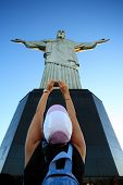 RIO DE JANEIRO, BRAZIL - JUNE 18, 2010: tourist taking a picture of the corcovado christ redeemer