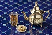Moroccan tea and cookie on a mosaic table