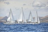 AEGEAN SEA, GREECE - APR 27, 2014: Unidentified sailboats participate in sailing regatta