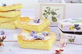 stock photo of custard  - piece of Custard Cake and violet flowers - JPG