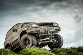 foto of dirt road  - Very muddy off road car - JPG