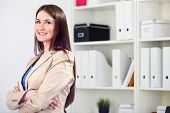 Sucessful business woman looking happy at office