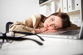 working woman sleeping on laptop in the workplace