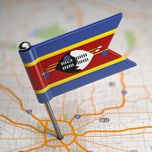 Swaziland Small Flag on a Map Background.
