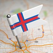Faroe Islands Small Flag on a Map Background.