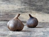 stock photo of fermentation  - Black garlic caused by weeks of fermentation - JPG