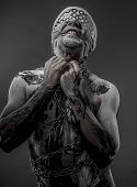 picture of blindfolded man  - man with chains and blindfolded concept of prison - JPG