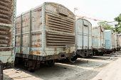 stock photo of argo  - Grey cargo train carriage in train yard taken on a sunny day - JPG