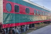 foto of railroad car  - red and green vintage railroad passenger car on a sidetrack - JPG