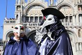 masked performers at Venice Carnival