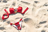 Red Swimwear On Sand. Holidays And Vacations.