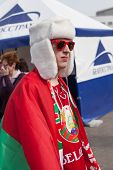 The hockey fan from Belarus in white hat