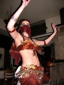 foto of belly-dance  - Young woman dancing - JPG