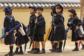NARA,JAPAN, NOVEMBER 18, 2011: Japanese young students are coming back from elementary school in Nara near Kyoto, Japan.