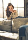 Portrait Of Happy Young Woman In Loft Apartment