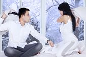 Couple Quarreling On Bed In Winter Day