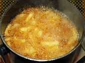 French Fries Cooking In Deep Fryer