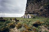image of iceland farm  - Abandoned farm under a lava rock face - JPG