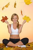 Young Woman Sitting Practice Yoga Under Leaves