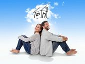 picture of married couple  - Young attractive and modern couple in love smiling happy together sitting on floor thinking and imaging their new house home flat or apartment in real state concept - JPG