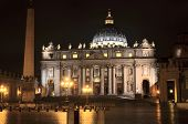 Monumental St. Peters Basilica at night in Vatican City.