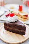 Chocolate Cake With Cherry And Whipped Cream