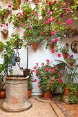 Courtyard with Flowers decorated and Old Well - Cordoba Patio Festival, Spain, Europe - 10 of May, 2013