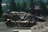 statue of sleeping sage on the entrance to Huangshan park