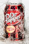 MOSCOW, RUSSIA-APRIL 4, 2014: Can of Dr Pepper Cherry Vanilla soft drink in water Dr Pepper is a soft drink marketed as having a unique flavor. The drink was created in the 1880s.