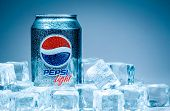 MOSCOW, RUSSIA-APRIL 4, 2014: Can of Pepsi cola on ice. Pepsi is a carbonated soft drink that is produced and manufactured by PepsiCo. Created and developed in 1893.