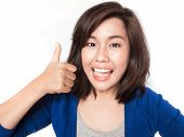 Isolated Portrait Of Beautiful Young Success Woman Giving Thumbs Up