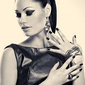 Woman with black nails and with stylish bijouterie. Black or white image concept