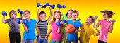 stock photo of sportive  - Team of sportive children friends with dumbbells and ball over yellow  - JPG