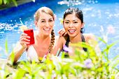 image of bathing  - Two girls or women in vacation - JPG