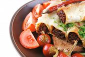 traditional italian cannelloni with mince meat and tomato