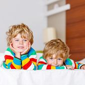 Two Little Sibling Kid Boys Having Fun In Bed After Sleeping