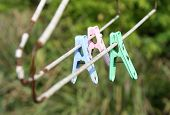 Old Color Plastic Clothespin Hanging On Old Clothes Hanger