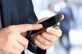 Businessman Holding  And Using The  Mobile  Smart  Phone