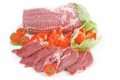 raw meat on white plate with vegetables