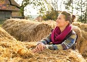 Happy Young Woman Near Haystack Looking On Copy Space