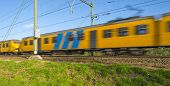 stock photo of high-speed train  - Passenger train moving at high speed in autumn - JPG