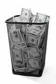 picture of dustbin  - Money in dustbin on grey background - JPG