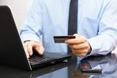 Businessman Is Using Credit Card For On Line Payment On Laptop
