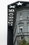 Facade And Roof Of The House Of Terror In Budapest - Vertical