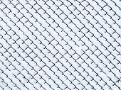 stock photo of chain link fence  - Chain link fence covered with fresh snow - JPG