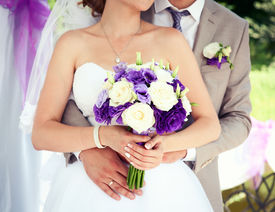 stock photo of hand kiss  - Happy bride and groom on their wedding - JPG