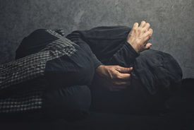 picture of underworld  - Drug Addict laying on the floor in agony having an addiction crisis - JPG