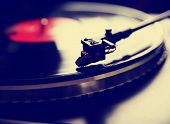stock photo of instagram  - Close up view of old fashioned turntable playing a track from black vinyl toned with a retro vintage instagram filter effect app or action  - JPG