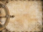 picture of treasure map  - steering wheel and blank vintage nautical map background - JPG